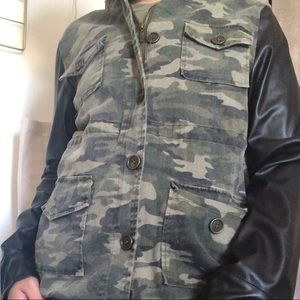Camo jacket with faux leather sleeves
